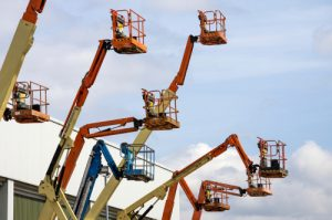 High reach work platforms extended upwards